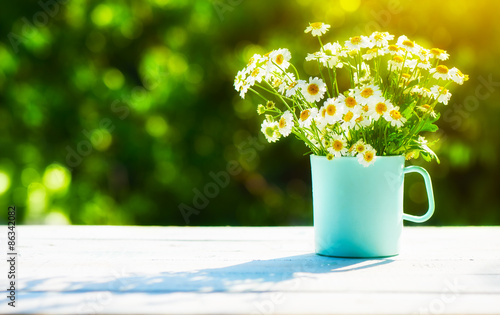 Fototapety, obrazy: bouquet of wild flowers in  cup on wooden table on a background