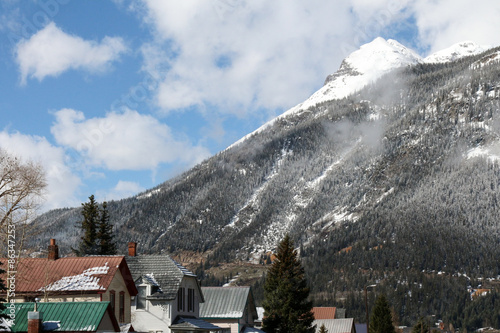 Fotografie, Obraz  Homes in downtown Silverton, Colorado, surrounded by snow capped mountains