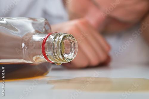 Spoed Foto op Canvas Bar Drunk Man With A Bottle Of Liquor
