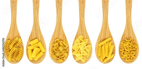 Fotografie, Obraz  Wooden cooking spoons filled with various types dry pasta