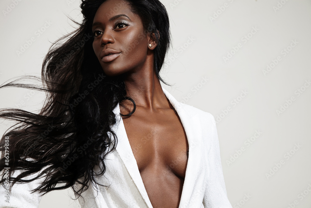 Fototapeta beauty black woman with a stright blowing hair