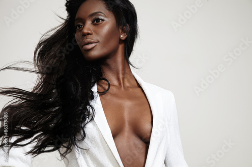 Canvas-taulu beauty black woman with a stright blowing hair