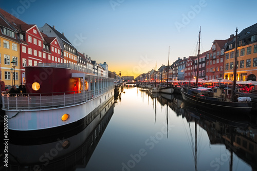 Photo  Ships in Nyhavn at sunset, Copenhagen, Denmark
