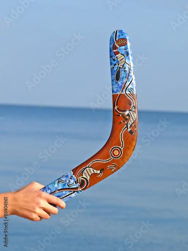 Photo Boomerang in woman hand taken closeup.