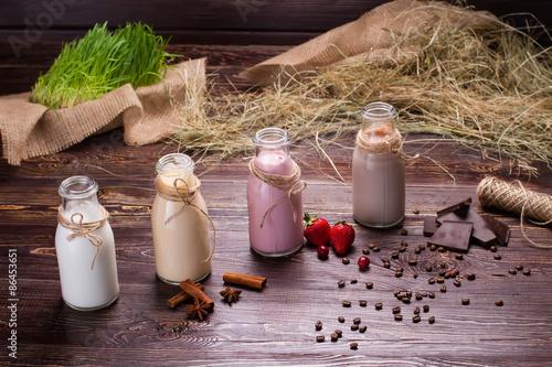 Foto op Aluminium Milkshake Natural milkshakes on the background.