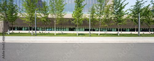 Fotografiet modern building with empty road floor