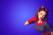 canvas print picture - Red hair beautiful curious pin-up girl on a blue background with copy space