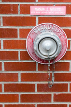 Manual Standpipe On A Red Bric...