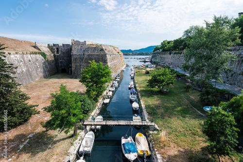 City on the water Fishing boats in canal under Old Venetian Fortress, Kerkyra, Corfu island, Greece