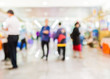 Blurred image of people walking at day market , blur background