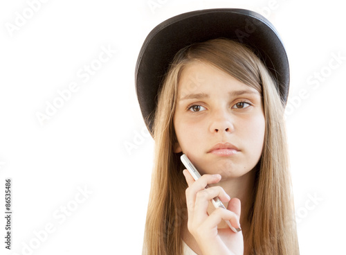 340bff1dad5 A close-up portrait of an attractive young girl in hat with a sad look
