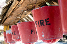 Old Worn Fire Buckets Hang Ove...