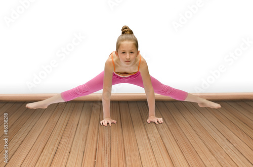 Foto op Canvas Gymnastiek child does gymnastics