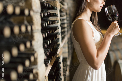 Young woman in the wine cellar Fototapet