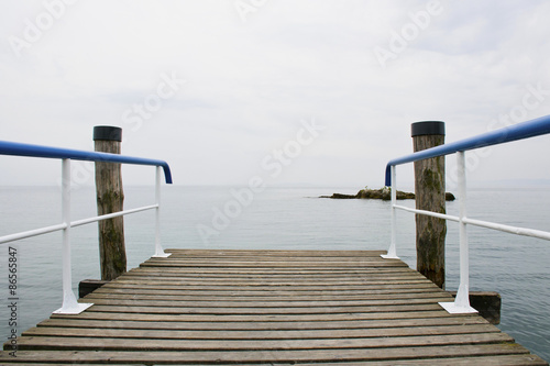 Fototapety, obrazy: Wooden deck that overlooks Lake Garda - Veneto