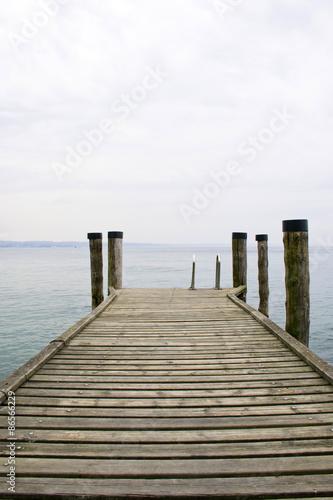 Fototapety, obrazy: Wooden deck that overlooks Lake Garda - Veneto
