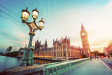 Fototapeta London - Big Ben, London the UK at sunset. Retro street lamp light on Westminster Bridge. Vintage