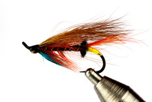 Salmon Fishing Fly On Fly Tying Vise Isolated On White