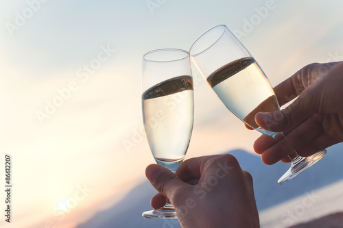 Vászonkép toast at sunset with white wine flute