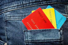 Three Colorful Credit Cards In The Jeans Pocket