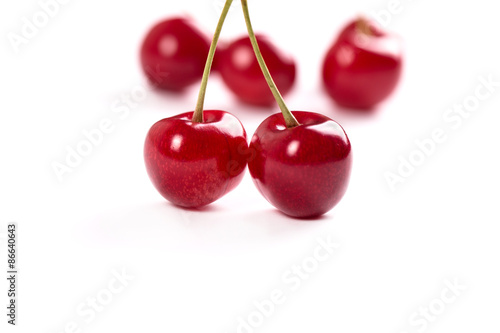 Nice and juicy cherries on a white background