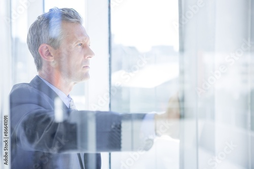 Fotografering  Thinking businessman in the office