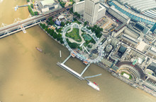 Helicopter View Of London Eye And Buildings Along Thames River
