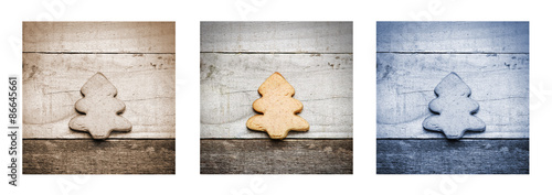 Fotomural homemade biscuit in Christmas tree shape on wooden background, triptych in blue,