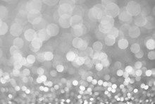 Gray And White Bokeh Lights Defocused. Abstract Background