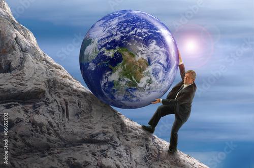 Photo  Sisyphus metaphor man rolling huge Earth rock ball up hill