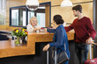 Couple Giving Passports To Receptionist
