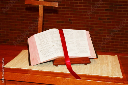 holy bible on table in church
