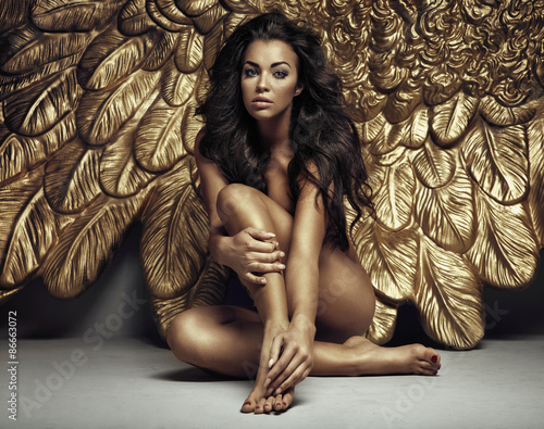 Fotografie, Obraz  Portrait of a cute angel with gold wings