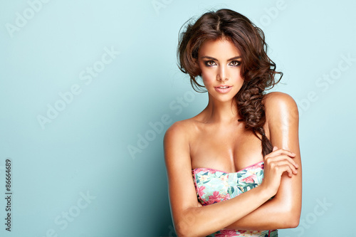 Portrait of a smiling brunette lady Wallpaper Mural