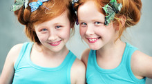 Smiling Redhead Sisters With B...