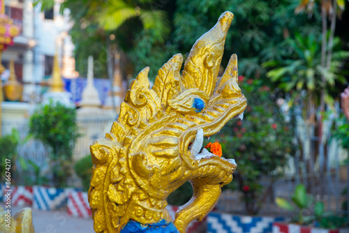 Photo Stands Bali Sculpture at the temple,dragon. Laos, Vientiane.