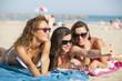 Three friends at the beach getting a selfie