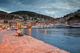 Fototapeta Do pokoju - Yachts mooring at a quay at the busiest part of the port in Hydra, Greece.