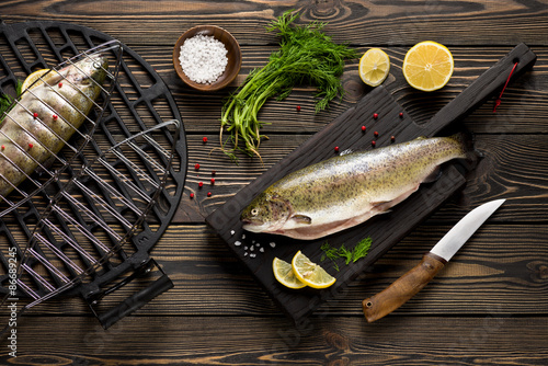 Fresh whole trout fishes prepared to grill top view Fototapeta