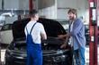 Man at automobile repair shop