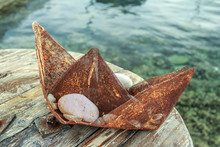 Souvenir Boat Made Of Rusty Metal Wire Gauze Mesh At Sea Water