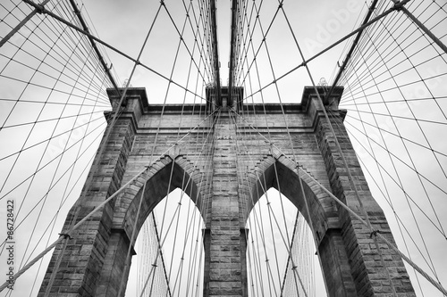 Aluminium Prints Brooklyn Bridge Brooklyn Bridge New York City close up architectural detail in timeless black and white