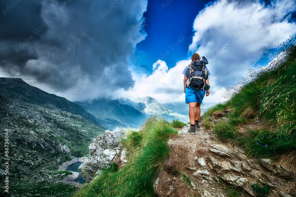 Fototapety, obrazy: Lonely woman hiker in a mountain path