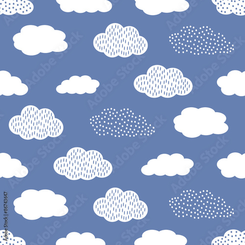 Seamless pattern with white clouds on blue background. Wallpaper Mural