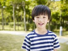 Outdoor Portrait Of A Little Asian Boy