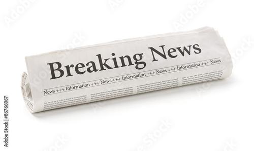 Fototapeta Rolled newspaper with the headline Breaking news obraz