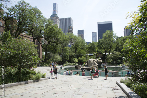 Visitors around the sea lions area at Central Park Zoo Manhattan New York USA