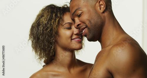 Slika na platnu Happy black couple kissing and laughing