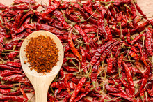 Red Dried Chili Pepper And Chili Flakes On Wooden Spoon