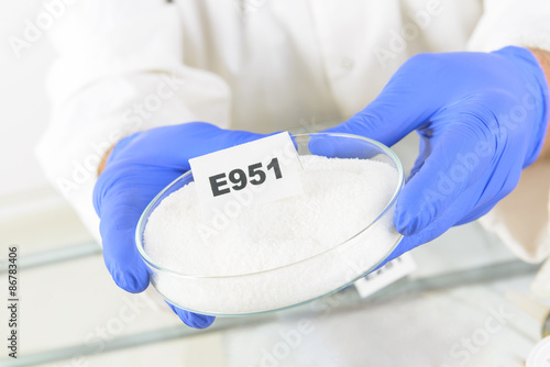 Photo Researcher holding sweetener E951